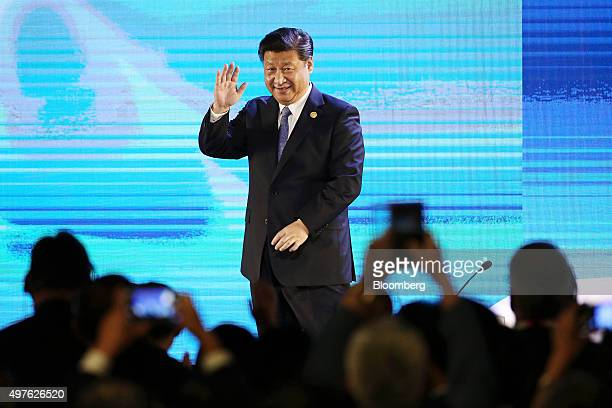 Xi Jinping China's president waves as he leaves the stage at the AsiaPacific Economic Cooperation CEO Summit in Manila the Philippines on Wednesday...