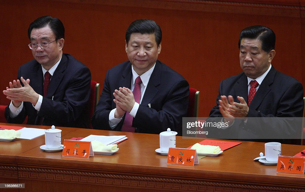 <a gi-track='captionPersonalityLinkClicked' href=/galleries/search?phrase=Xi+Jinping&family=editorial&specificpeople=2598986 ng-click='$event.stopPropagation()'>Xi Jinping</a>, China's vice president, center, claps during the closing session of the 18th National Congress of the Communist Party of China at the Great Hall of the People in Beijing, China, on Wednesday, Nov. 14, 2012. Xi and Vice Premier Li Keqiang were reappointed to the Chinese Communist Party's Central Committee, positioning them to take over the top two posts in the world's second-biggest economy. Photographer: Tomohiro Ohsumi/Bloomberg via Getty Images