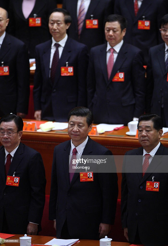 Xi Jinping, China's vice president, front row center, attends the closing session of the 18th National Congress of the Communist Party of China at the Great Hall of the People in Beijing, China, on Wednesday, Nov. 14, 2012. Xi and Vice Premier Li Keqiang were reappointed to the Chinese Communist Party's Central Committee, positioning them to take over the top two posts in the world's second-biggest economy. Photographer: Tomohiro Ohsumi/Bloomberg via Getty Images