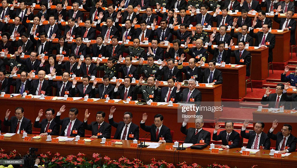 Xi Jinping, China's vice president, front row third left, Hu Jintao, China's president, front row fifth right, Jiang Zemin, former president, front row fourth right, Wen Jiabao, China's premier, front row third right, and Li Keqiang, vice premier, front row right, attend the closing session of the 18th National Congress of the Communist Party of China at the Great Hall of the People in Beijing, China, on Wednesday, Nov. 14, 2012. Xi and Li were reappointed to the Chinese Communist Party's Central Committee, positioning them to take over the top two posts in the world's second-biggest economy. Photographer: Tomohiro Ohsumi/Bloomberg via Getty Images