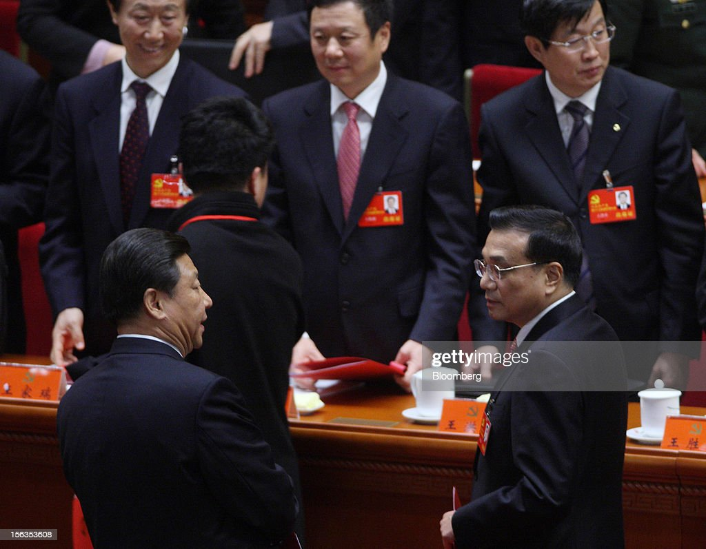 Xi Jinping, China's vice president, left, and Li Keqiang, vice premier, prepare to leave the closing session of the 18th National Congress of the Communist Party of China at the Great Hall of the People in Beijing, China, on Wednesday, Nov. 14, 2012. Xi and Li were reappointed to the Chinese Communist Party's Central Committee, positioning them to take over the top two posts in the world's second-biggest economy. Photographer: Tomohiro Ohsumi/Bloomberg via Getty Images