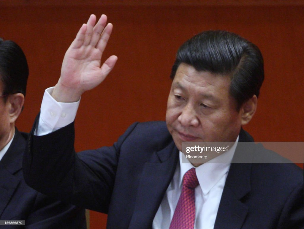 <a gi-track='captionPersonalityLinkClicked' href=/galleries/search?phrase=Xi+Jinping&family=editorial&specificpeople=2598986 ng-click='$event.stopPropagation()'>Xi Jinping</a>, China's vice president, raises his hand during the closing session of the 18th National Congress of the Communist Party of China at the Great Hall of the People in Beijing, China, on Wednesday, Nov. 14, 2012. Xi and Vice Premier Li Keqiang were reappointed to the Chinese Communist Party's Central Committee, positioning them to take over the top two posts in the world's second-biggest economy. Photographer: Tomohiro Ohsumi/Bloomberg via Getty Images