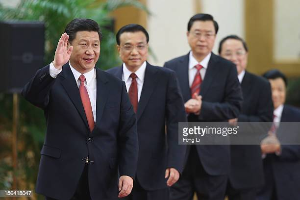 Xi Jinping Li Keqiang Zhang Dejiang Yu Zhengsheng and Liu Yunshan greet the media at the Great Hall of the People on November 15 2012 in Beijing...