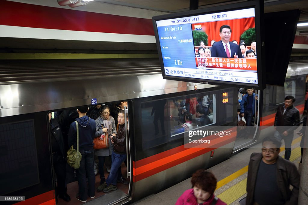 <a gi-track='captionPersonalityLinkClicked' href=/galleries/search?phrase=Xi+Jinping&family=editorial&specificpeople=2598986 ng-click='$event.stopPropagation()'>Xi Jinping</a>, newly named president of China, is seen during a news broadcast, displayed on a television monitor at a subway station in Beijing, China, on Thursday, March 14, 2013. Xi was named China's president by the national legislature, replacing Hu Jintao in the country's most rapid formal transfer of power in more than a generation. Photographer: Tomohiro Ohsumi/Bloomberg via Getty Images