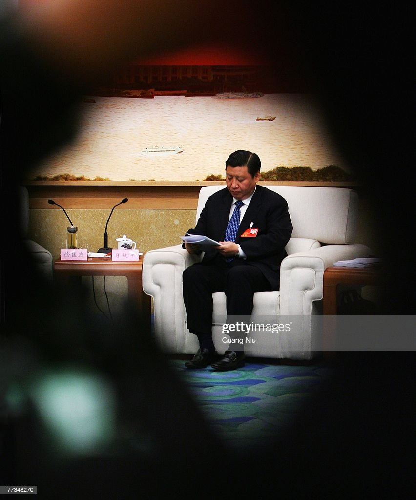 Xi Jinping, Shanghai's Communist Party chief, attends a group discussion during the second day of the five-yearly Chinese Communist Party Congress at the Great Hall of the People on October 16, 2007 in Beijing, China. The congress, which is held from October 15 to 21, will promote younger leaders and likely successors to President Hu Jintao and Premier Wen Jiabao in five years time.