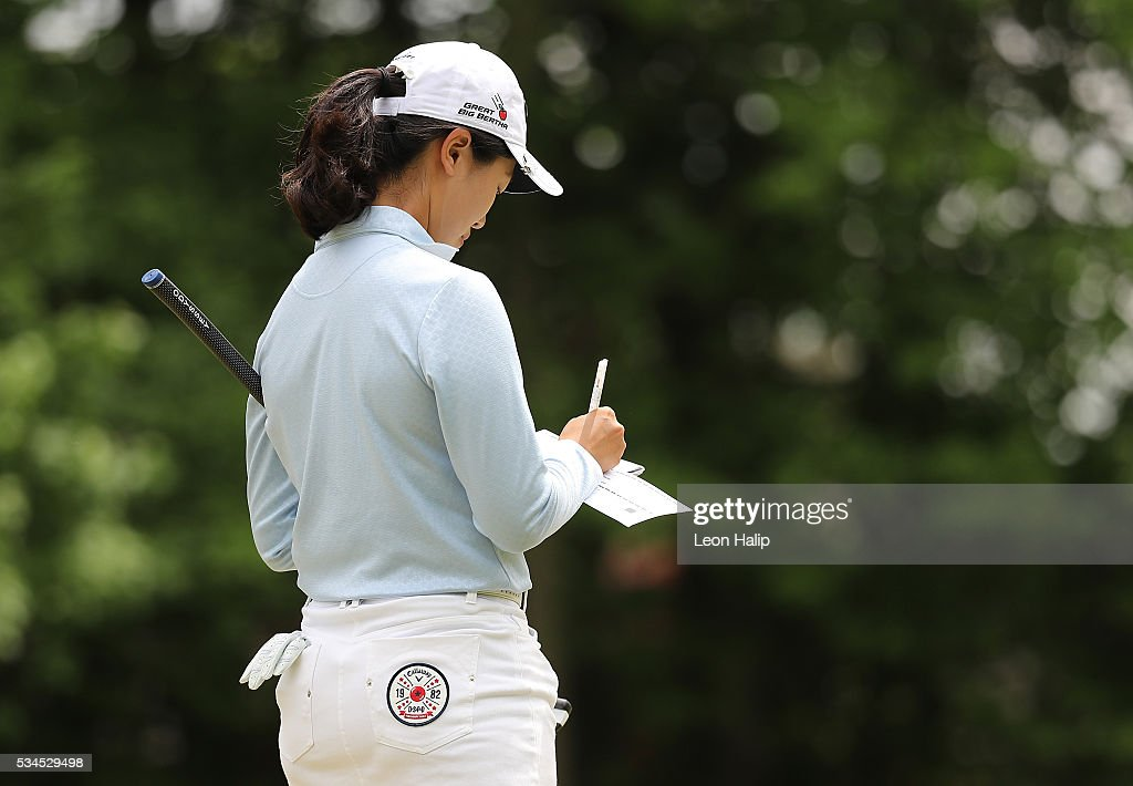 Xi Yu Lin of China checks her score card on the sixth hole during the first round of the LPGA Volvik Championship on May 26, 2016 at Travis Pointe Country Club Ann Arbor, Michigan.