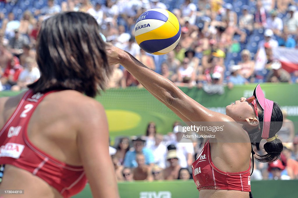 Xi Zhang (R) from China receives the ball during the match between China and Vanuatu during Day 5 of the FIVB World Championships on July 5, 2013 in Stare Jablonki, Poland.