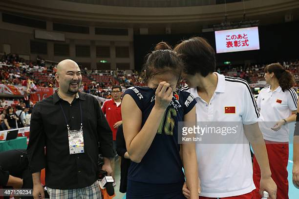 Xia Ding of China cries next to her Head coach Ping Lang after victory the match between Japan and China during the FIVB Women's Volleyball World Cup...