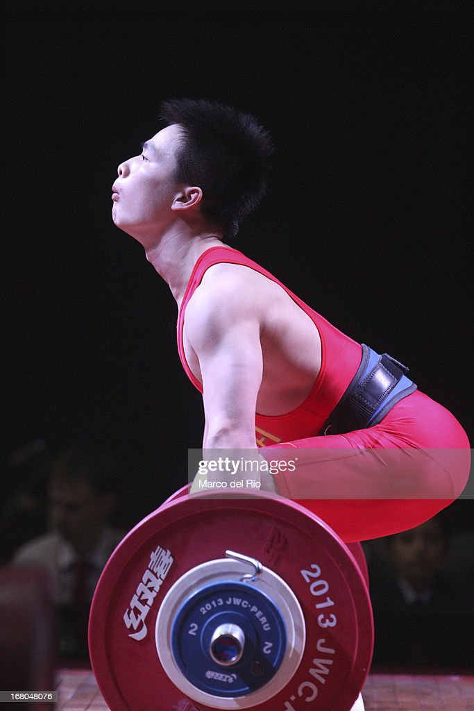 Xiameng Wei of China A competes in the Men's 56kg during day one of the 2013 Junior Weightlifting World Championship at Maria Angola Convention Center on April 04, 2013 in Lima, Peru.