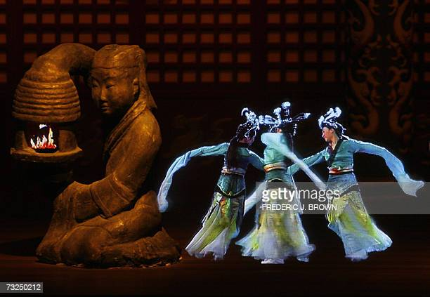 Dancers appear to perform on stage in a 3D holographic display at the Yang Ling Tomb for the Han Dynasty's Jing Di emperor who ruled from 188 to 141...