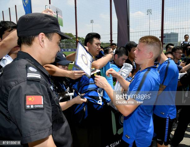 Xian Emmers of FC Internazionale signs autographs for fans after a FC Interazionale training session at Suning training center on July 20 2017 in...