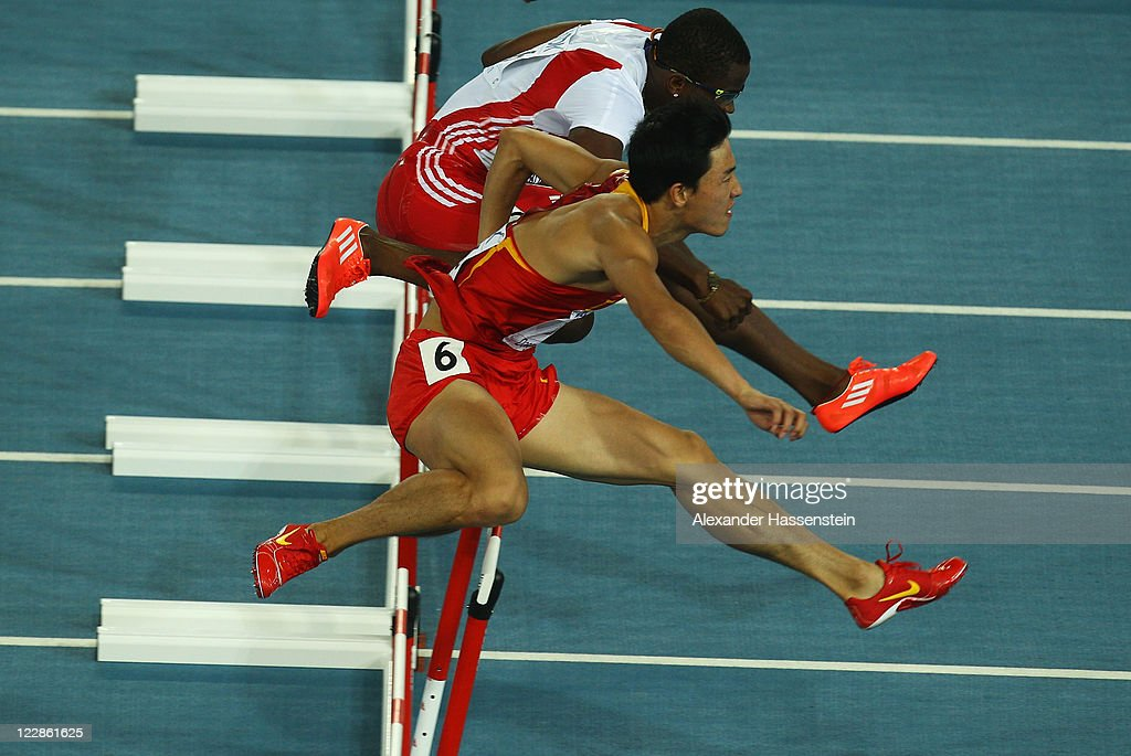 Xiang Liu (bottom) of China and <a gi-track='captionPersonalityLinkClicked' href=/galleries/search?phrase=Dayron+Robles&family=editorial&specificpeople=812613 ng-click='$event.stopPropagation()'>Dayron Robles</a> of Cuba compete in the men's 110 metres hurdles final during day three of the 13th IAAF World Athletics Championships at the Daegu Stadium on August 29, 2011 in Daegu, South Korea. Richardson was awarded the gold medal after <a gi-track='captionPersonalityLinkClicked' href=/galleries/search?phrase=Dayron+Robles&family=editorial&specificpeople=812613 ng-click='$event.stopPropagation()'>Dayron Robles</a> of Cuba was disqualified.