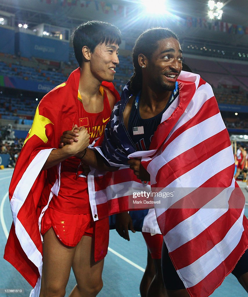 Xiang Liu (L) of China and <a gi-track='captionPersonalityLinkClicked' href=/galleries/search?phrase=Jason+Richardson+-+Hurdler&family=editorial&specificpeople=15223987 ng-click='$event.stopPropagation()'>Jason Richardson</a> of United States celebrate after the men's 110 metres hurdles final during day three of the 13th IAAF World Athletics Championships at the Daegu Stadium on August 29, 2011 in Daegu, South Korea. Richardson was awarded the gold medal after <a gi-track='captionPersonalityLinkClicked' href=/galleries/search?phrase=Dayron+Robles&family=editorial&specificpeople=812613 ng-click='$event.stopPropagation()'>Dayron Robles</a> of Cuba was disqualified.