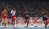 Xiang Liu of China Dayron Robles of Cuba David Oliver of United States and Jason Richardson of United States compete in the men's 110 metres hurdles...