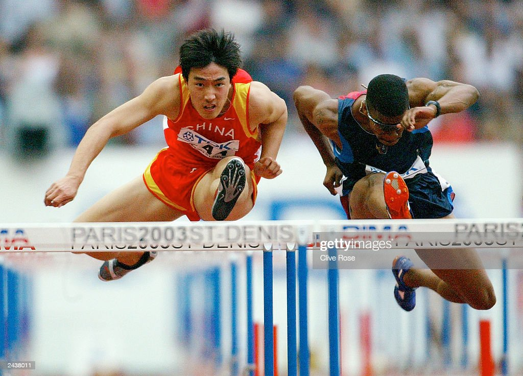 Xiang Liu of China leads the pack in the 110m hurdles heats at the 9th IAAF World Athletics Championship August 28, 2003 in Paris.