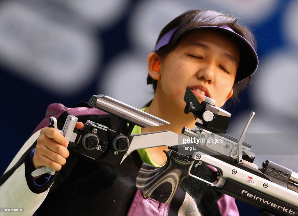 Xiang Wei Jasmine celebrates winning gold during the Womens 10m air rifle singles event at the Dr Karni Singh Shooting Range during day seven of the Delhi 2010 Commonwealth Games on October 10, 2010 in Delhi, India.