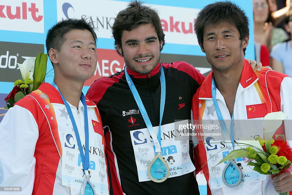 Xiang Xu of China silver Alexandre Despatie of Canada gold and Feng Wang of China bronze pose on the podium after the men's one meter springboard...