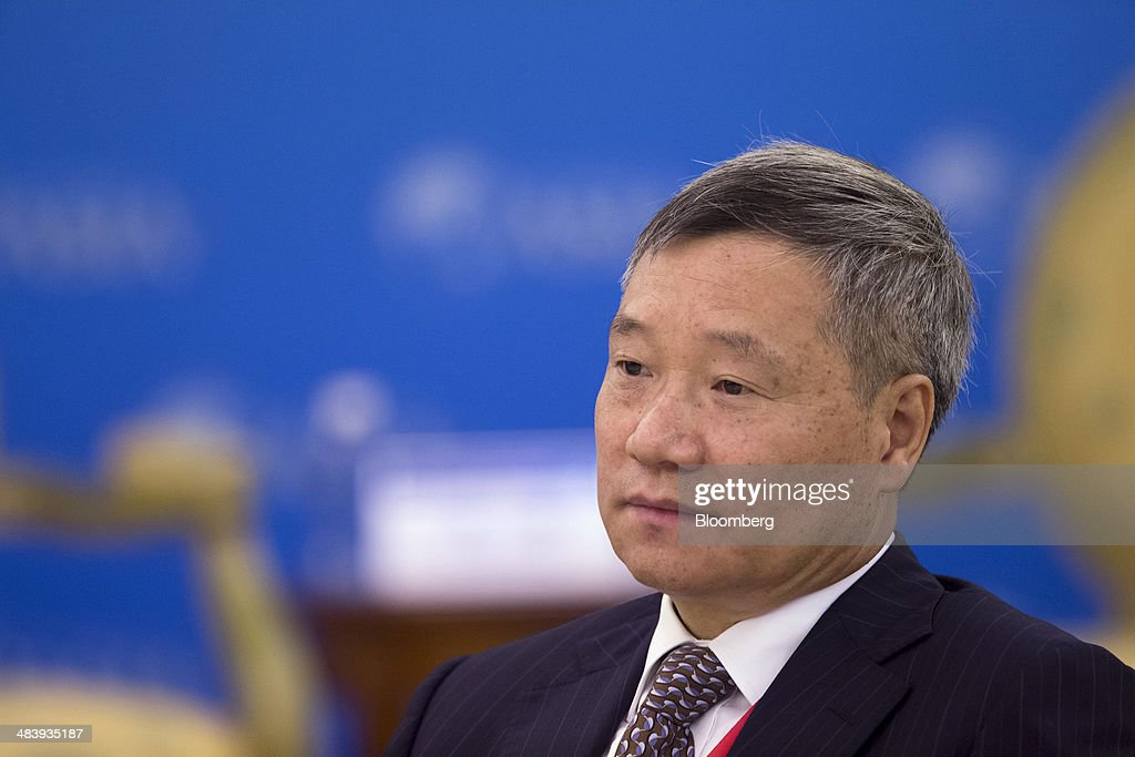 Xiao Gang, chairman of the China Securities Regulatory Commission, listens during a session at the Boao Forum for Asia in Boao, Hainan, China, on Thursday, April 10, 2014. The Boao Forum for Asia takes place from April 8-11. Photographer: Brent Lewin/Bloomberg via Getty Images
