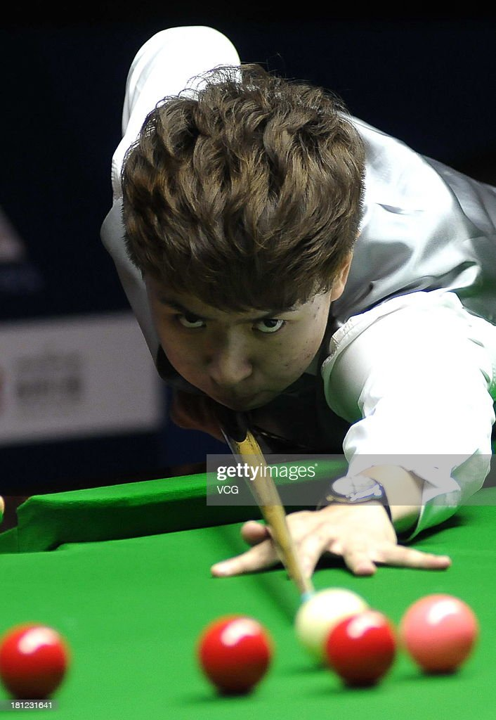 Xiao Guodong of China plays a shot in the match against Peter Lines of England on day four of the 2013 World Snooker Shanghai Master at Shanghai Grand Stage on September 19, 2013 in Shanghai, China.