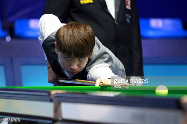 Xiao Guodong of China reacts against Pankaj Advani of India on Day one of the 2014 Snooker Haikou World Open on March 10 in Haikou Hainan China