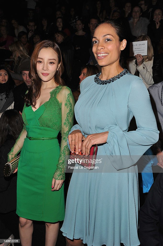 Xiao Lu Li (L) and Rosario Dawson (R) attend the Elie Saab Ready-To-Wear Fall/Winter 2012 show as part of Paris Fashion Week at Espace Ephemere Tuileries on March 7, 2012 in Paris, France.