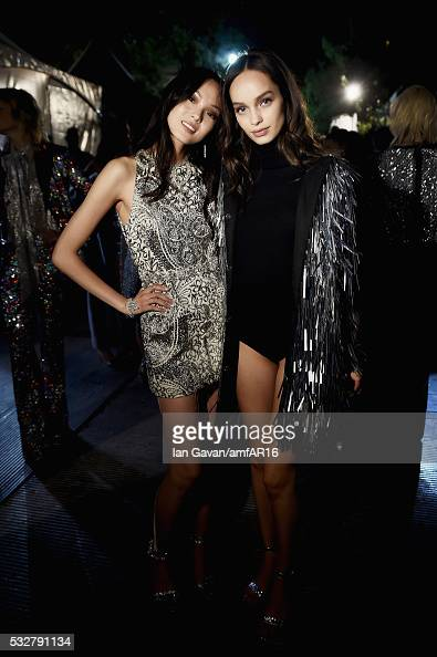 Xiao Wen Ju and Luma Grothe prepare backstage at the amfAR's 23rd Cinema Against AIDS Gala at Hotel du CapEdenRoc on May 19 2016 in Cap d'Antibes...