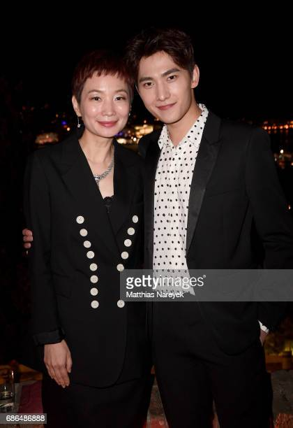 Xiao Xue and Yang Yang attend the Women in Motion Awards Dinner at the 70th Cannes Film Festival at Place de la Castre on May 21 2017 in Cannes France
