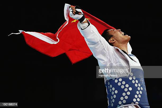 Xiaobo Liu of China celebrates beating Bahri Tanrikulu of Turkey during the Bronze medal match on Day 15 of the London 2012 Olympic Games at ExCeL on...