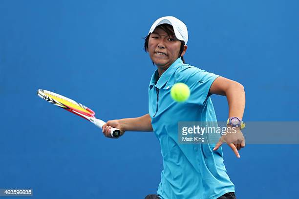 XiaoDi You of China plays a forehand in her first round junior girls' match against Anastasia Shaulskaya of Russia during the 2014 Australian Open...