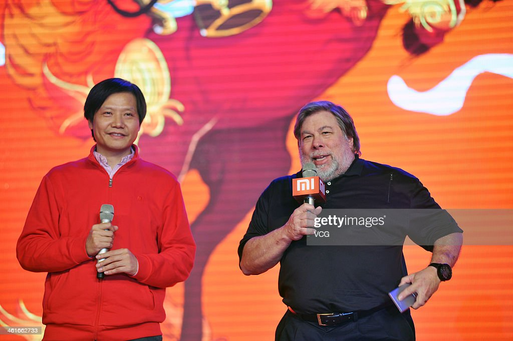 Xiaomi CEO Lei Jun (L) and Steve Wozniak, co-founder of Apple Inc. and chief scientist of Fusion-io Inc., attend the Xiaomi 2013 Annual Conference at China National Convention Center on January 10, 2014 in Beijing, China. China's smartphone maker Xiaomi Corp sold 18.7 million smartphones in 2013, and its revenue reached 31.6 billion yuan (5.2 billion U.S. dollars) before tax.