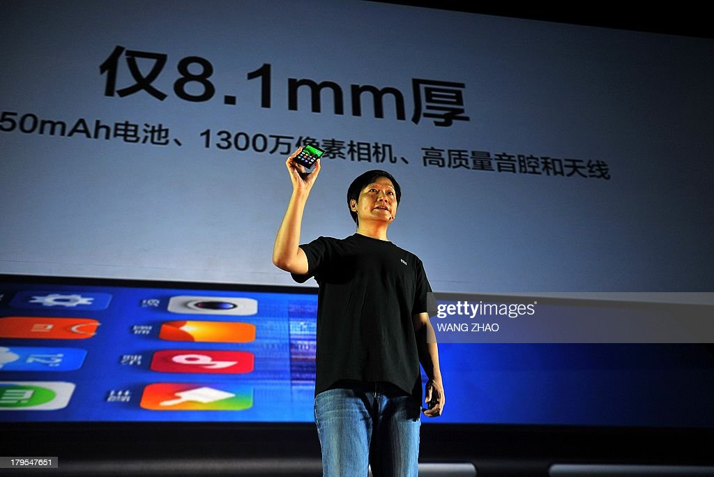 Xiaomi CEO Leijun shows a new Xiaomi smartphone at the launch of the new Xiaomi smartphone and Xiaomi Tv in Beijing on September 5, 2013. China's Xiaomi has poached a key Google executive involved in the tech giant's Android phones, in a move seen as a coup for the rapidly growing Chinese smartphone maker.