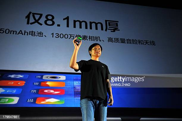 Xiaomi CEO Leijun shows a new Xiaomi smartphone at the launch of the new Xiaomi smartphone and Xiaomi Tv in Beijing on September 5 2013 China's...