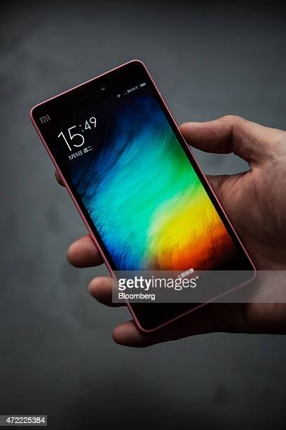 A Xiaomi Corp Mi 4i smartphone is displayed for a photograph during a news conference in Hong Kong China on Tuesday May 5 2015 The Mi 4i which runs...