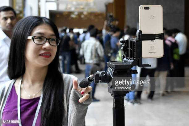 A Xiaomi Corp Mi A1 dual camera device is attached to a tripod ready to take a photograph during the smartphone's launch in New Delhi India on...