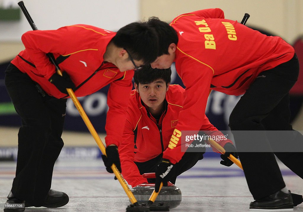 Xiaoming Xu of China delivers his stone during the Pacific Asia 2012 Curling Championship at the Naseby Indoor Curling Arena on November 23, 2012 in Naseby, New Zealand.