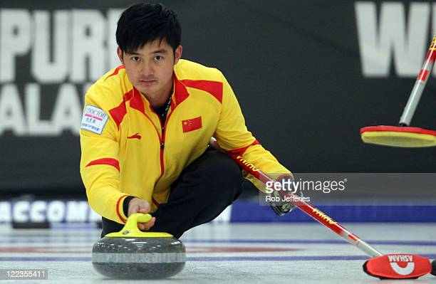 Xiaoming Xu of China releases a stone during the Curling Finals match between China and Korea on day 16 of the Winter Games NZ at Maniototo...