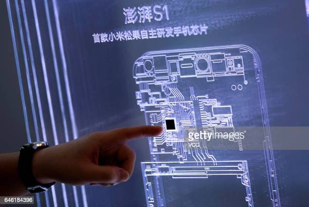 Xiaomi's first inhouse chip Surge S1 is displayed during a press conference on February 28 2017 in Beijing China Chinabased electronics company...