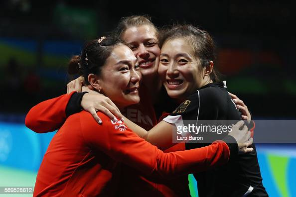 Xiaona Shan Petrissa Solja and Ying Han of Germany react after defeating Japan 32 in the Women's Team Semifinal 2 on Day 9 of the Rio 2016 Olympic...