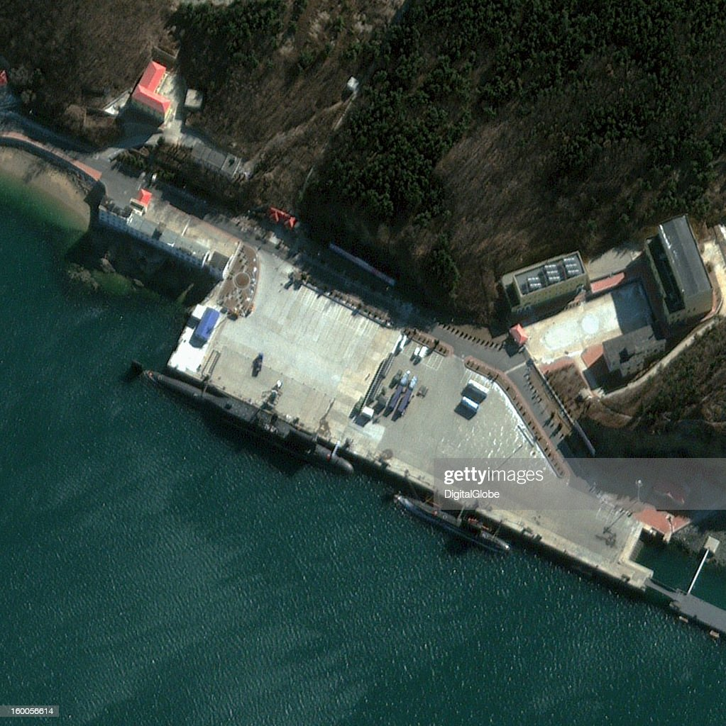 Xiaopingdao Naval Base, also referred to as the 62nd Submarine Training Base, is located on the Yellow Sea just outside of Dalian in Liaoning Province, 450 kilometers east-southeast of Beijing, China. The base is operated by the Chinese People's Liberation Army Navy (PLAN) North Sea Fleet and is believed be used to prepare submarines for ballistic missile testing. This January 17, 2013, satellite image shows one Type 094 Jin Class (SSBN) submarine, one possible Qing Class (SSB) submarine and two Type 041 Yuan Class (SSK) submarines at the base.
