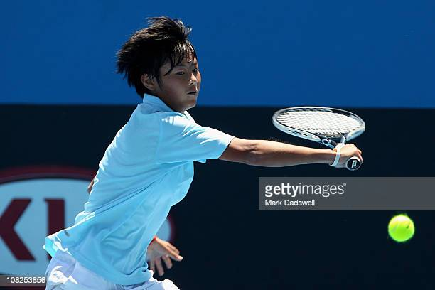 Xiaorong Dong of China plays a backhand in her first round juniors match against Caroline Garcia of France during day seven of the 2011 Australian...