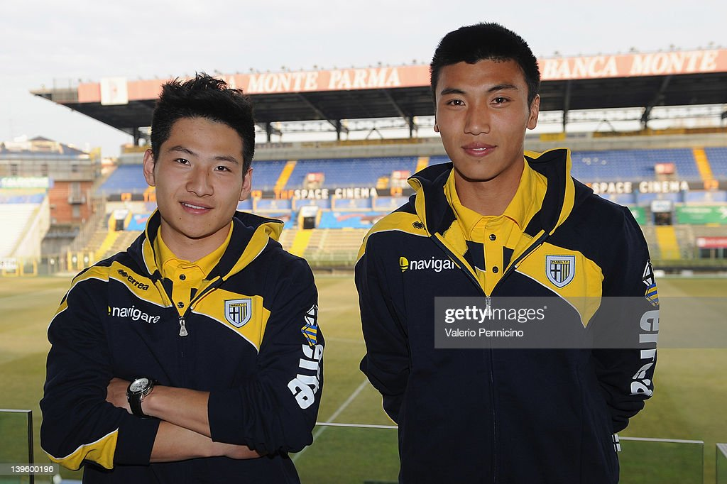 XiaoTian Yang and Cheng Qu of Jangsu Sainty Football Club prior to a Parma FC press conference to officially annouce the partnership between Parma FC...