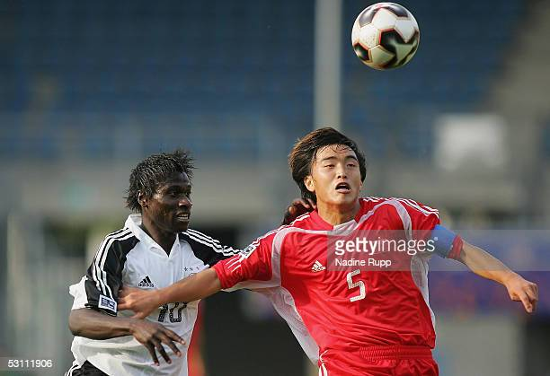 Xiaoting Feng of China in action with Sahr Senesie of Germany during the FIFA World Youth Championship match between China and Germany on June 21...