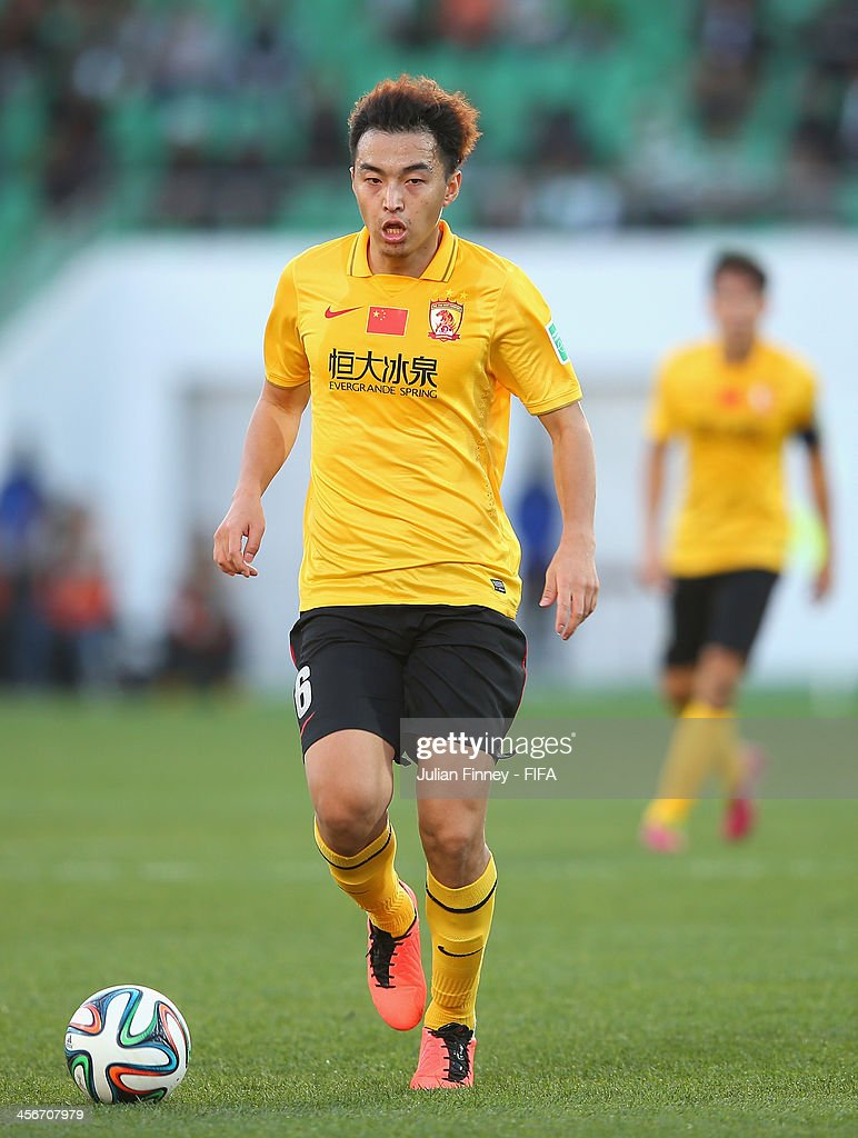 <a gi-track='captionPersonalityLinkClicked' href=/galleries/search?phrase=Xiaoting+Feng&family=editorial&specificpeople=2333049 ng-click='$event.stopPropagation()'>Xiaoting Feng</a> of Guangzhou Evergrande FC in action during the FIFA Club World Cup Quarter Final match between Guangzhou Evergrande FC and Al-Ahly SC at the Agadir Stadium on December 14, 2013 in Agadir, Morocco.