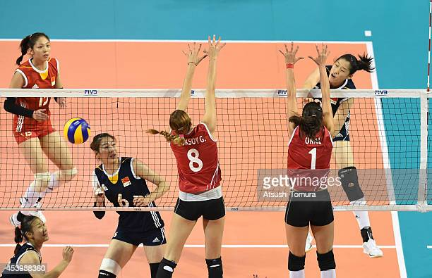 Xiaotong Liu of China spikes the ball during the FIVB World Grand Prix Final group one match between Turkey and China on August 23 2014 in Tokyo Japan