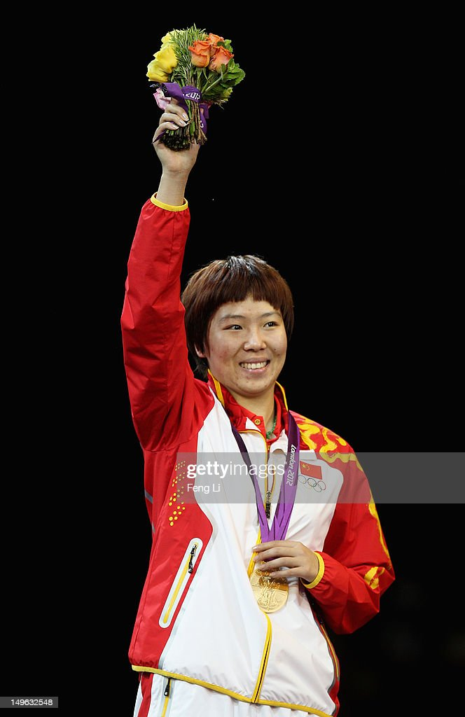 <a gi-track='captionPersonalityLinkClicked' href=/galleries/search?phrase=Xiaoxia+Li&family=editorial&specificpeople=4049514 ng-click='$event.stopPropagation()'>Xiaoxia Li</a> of China celebrates on the podium after winning the Gold medal in the Women's Singles Table Tennis Gold Medal match against Ning Ding of China on Day 5 of the London 2012 Olympic Games at ExCeL on August 1, 2012 in London, England.