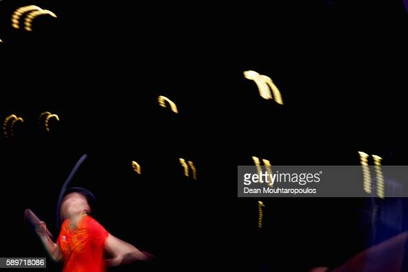 Xiaoxia Li of China competes against Tianwei Feng of Singapore during the Table Tennis Women's Team Round Semi Final between China and Singapore...