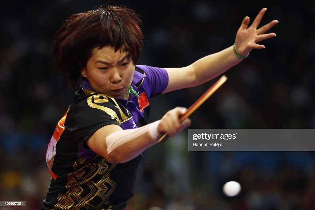 <a gi-track='captionPersonalityLinkClicked' href=/galleries/search?phrase=Xiaoxia+Li&family=editorial&specificpeople=4049514 ng-click='$event.stopPropagation()'>Xiaoxia Li</a> of China plays a forehand in the Women's Doubles Final with Yue Guo of China against Ning Ding and Shiwen Liu of China at Guangzhou Gymnasium during day seven of the 16th Asian Games Guangzhou 2010 on November 19, 2010 in Guangzhou, China.