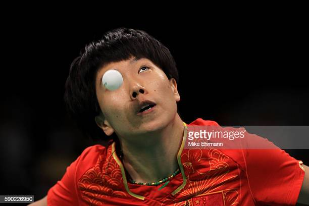 Xiaoxia Li of China plays a match against Ying Han of Germany in the Women's Team Gold Medal Team Match between China and Germany on Day 11 of the...
