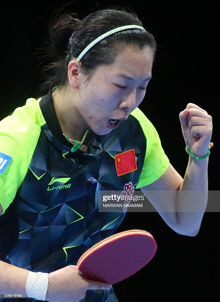 Xiaoxia Li of China reacts after winning a point against Tianwei Feng of Singapore during their women's singles semi final table tennis match in the ITTF Nakheel Table Tennis Asian Cup, on April 29, 2016 in Dubai. / AFP / MARWAN