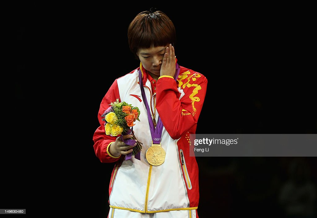 <a gi-track='captionPersonalityLinkClicked' href=/galleries/search?phrase=Xiaoxia+Li&family=editorial&specificpeople=4049514 ng-click='$event.stopPropagation()'>Xiaoxia Li</a> of China reacts on the podium after winning the Gold medal in the Women's Singles Table Tennis Gold Medal match against Ning Ding of China on Day 5 of the London 2012 Olympic Games at ExCeL on August 1, 2012 in London, England.